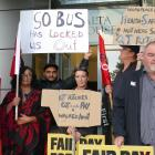 Four Ritchies bus drivers, along with First Union organiser Ken Young and other union members,...