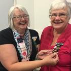 Mavis Wilkins, of Lowcliffe Women's Institute (WI), is given her WI 50-year pin by outgoing Mid...