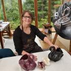 Rod Eales' collection of Crown Lynn swans has inspired her art such as Shadows and Ghosts. Photo:...