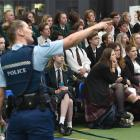 Constable Emily Plew speaks to secondary school pupils at a Safer Journeys Expo yesterday morning...