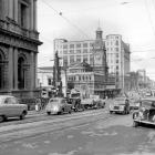 "The Stock Exchange building stands in front of the Chief Post Office in 1952... ""One of the most..."