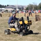 Local man Tom McCone takes part in a lawn mower race at the Strath Taieri A&P Show at...