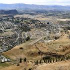 In the foreground is the expanding Meadowstone suburb, with central Wanaka and Mt Iron in ...