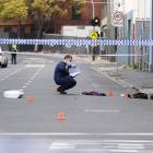 A Victoria Police personnel works at the scene of a multiple shooting outside Love Machine...