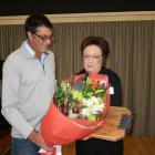Sue Edgerton accepts her late husband Ewen 'Uge' Edgerton's posthumous life membership from Jim O...