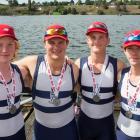 Teddy (left) with the silver medal-winning Otago Boys' High School quadruple sculls crew (from...