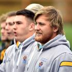 University prop Angus Williams (right) watches his side play Kansai Universities at Logan Park...