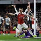 Arsenal's Aaron Ramsey celebrates before realising his goal was disallowed against Newcastle....