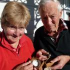 Heather and Alan Duthie, of Clydevale, examine some of Mr Duthie's great uncle Robert's World War...