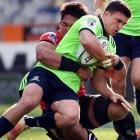 Bravehearts first five-eighth Bryn Gatland is tackled by Wolf Pack flanker Kazuki Himene at...