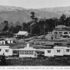 Completed shelters for consumptives, and the main building under construction at the new...