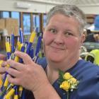 After earlier assembling plenty of pens, Cargill Enterprises worker Deborah Rielly finished...