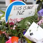 Floral tributes to the shooting victims near the Al Noor mosque in Christchurch. Photo: Getty...