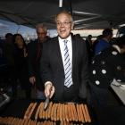 Australian PM Scott Morrison courts voters with sausages on the campaign trail in Tasmania. Photo...