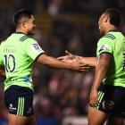 Josh Ioane (left) of the Highlanders celebrates scoring the team's fourth try with his team mate...