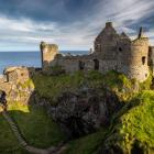 Dunluce Castle sits perched on the dramatic coastal cliffs of north County Antrim. Photos: Getty...