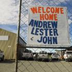 """A """"welcome home"""" sign at Southern Lakes Helicopters for the trio who were involved in a..."""