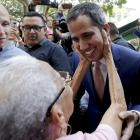 Juan Guaido, Venezuelan opposition leader and self-proclaimed interim president, is greeted by a...