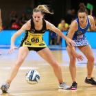 Katrina Rore shields the ball from Grace Kukutai during the Central Pulse's win over the Northern...