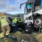 Firefighters at the scene of a double fatal crash near Kingston last year. Photo: Supplied