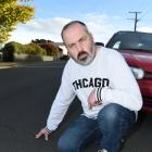 Dunedin resident Lesley Chave is not happy at the cracked condition of Aberdeen Rd, but the...