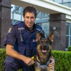 Constable Marcus Saunders and patrol dog Vann outside the Dunedin Central Police Station. Photo:...