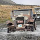 John Wilson, of Christchurch, splashes his 1929 Ford A through a creek on the Mavora Lakes road....