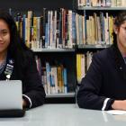 Otago Girls' High School pupils Moli Ahokovi (17, left) and Sofia Fortunato (19) show their...
