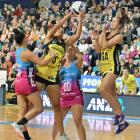 Central Pulse goal shoot Aliyah Dunn grabs a pass into the circle, despite the attention of...