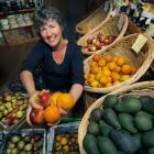 Robyn Guyton in the Riverton Environmental Centre with fruit that has been grown naturally. Spots...