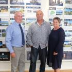 PGG Wrightson North Otago sales manager John Sinnamon with Tony and Belinda Spivey, of the...