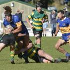 Action from today's premier club rugby match between Green Island and Taieri at Miller Park....