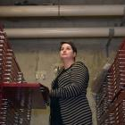 Dunedin City Council digital archivist Alison Breese, under overhead stormwater pipes, below the...