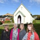 Standing in front of the 120-year-old  Mary Queen of Peace Church in Broad Bay  are (from left)...