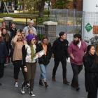 Postgraduate students and other members of the university community march at a rally demanding...