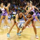 Whitney Souness and Holly Fowler compete for a loose ball during the Central Pulse's win over the...