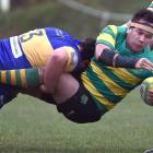 Green Island prop Peter Mirrielees is tackled by Taieri prop Kieran O'Sullivan in a match between...