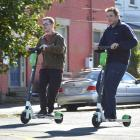 University of Otago students Luke Beer (left) and Levi Milton zoom through North Dunedin on Lime...