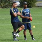 Highlanders and All Black halfback Aaron Smith (left) with Highlanders trainer Buxton Popoali'i...