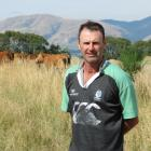Clark Scott, of Loch Head Limousin Stud, near Heriot, pictured with some of their R2 Limousin...
