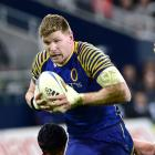 Adam Thomson on the charge for Otago in 2012. PHOTO: PETER MCINTOSH