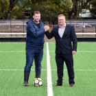 Football South CEO Chris Wright and chairman Matthew Holdridge stand on the completed football...