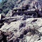 A bulldozer during the creation of the Haast road in the early 1960s.PHOTOS: TAS SMITH/ODT FILES