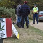 Police and council staff issue a trespass notice to the organisers of the Harvest Festival near...