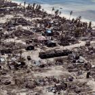 Buildings damaged during Cyclone Kenneth are seen from the air in a village north of Pemba,...