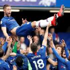 Chelsea's Gary Cahill is thrown in the air by his teammates after the match. Photo: Reuters