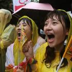 Same-sex marriage supporters shout during a parliamentary vote a same-sex marriage law, outside...