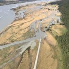 The Dart River flooding Kinloch's only access road in heavy rain. Photo: Mountain Scene