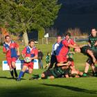Maniototo's Dean Chalmers looks for an opening in the dying minutes in the Country clash with...