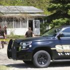 St. Joseph County Sheriff deputies stand outside the site where a woman was fatally shot in Fawn...